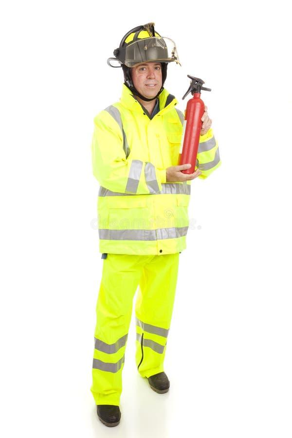 Bombeiro com extintor de incêndio foto de stock royalty free