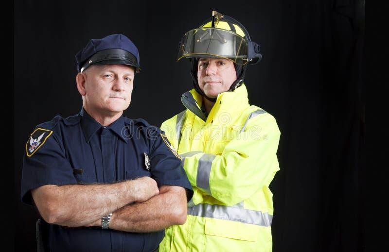 Bombeiro e polícia com Copyspace fotos de stock