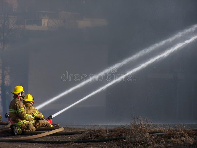 Bombeiros foto de stock