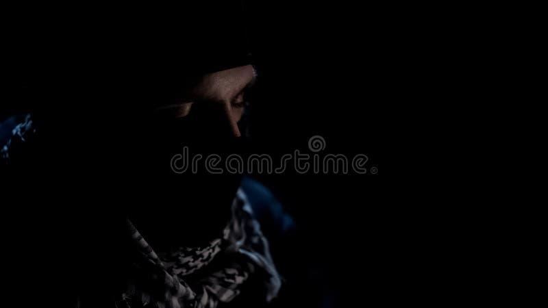 Bomber closed eyes, praying before suicide, militant Islamist organization. Stock photo stock photography