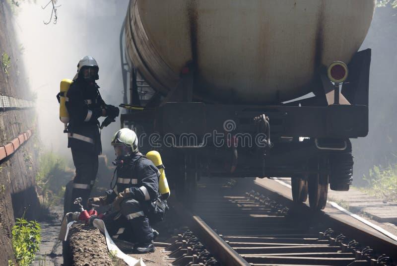 Bomberos del humo del tren del petrolero fotos de archivo