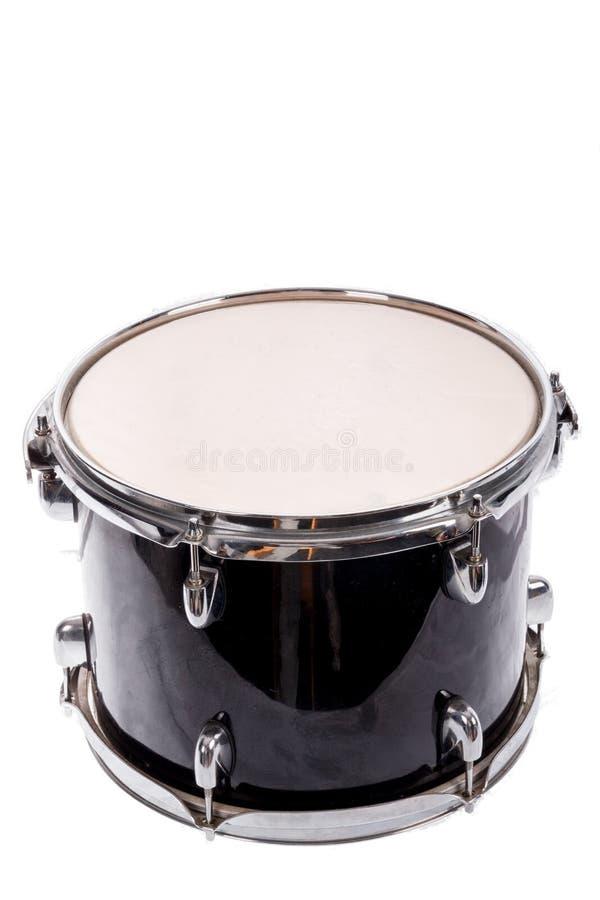 Bombo negro clásico de la música en el fondo blanco imagenes de archivo