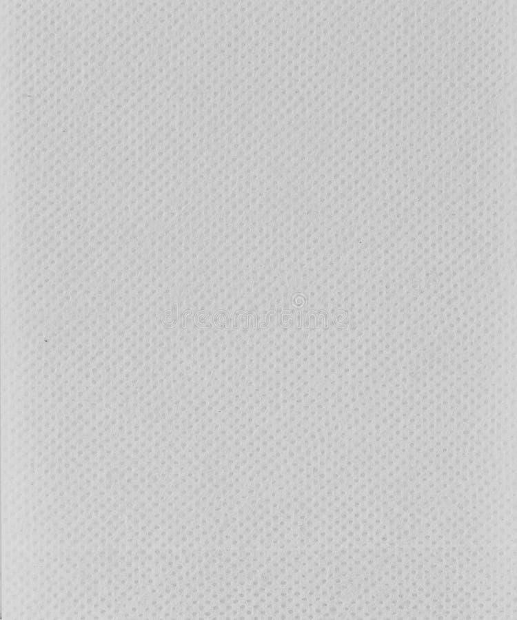 Bomullsfibrer texturerar bakgrund, stänger sig upp sikt av menstruations- tamponger eller block royaltyfri bild