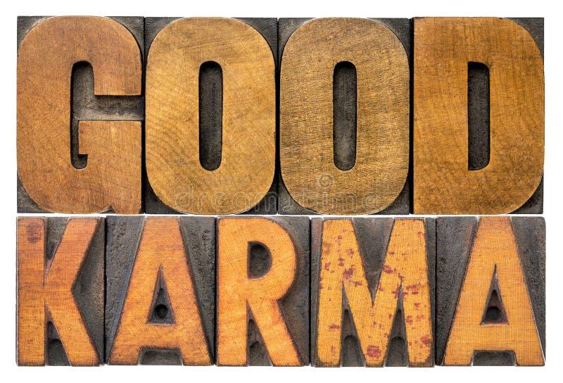 Bon abrégé sur mot de karma dans le type en bois de vintage photographie stock
