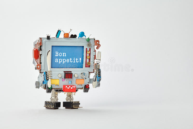 Bon appetit concept robotic chef character with fork and knife in arms. Retro style cyborg monitor face, blue screen royalty free stock images
