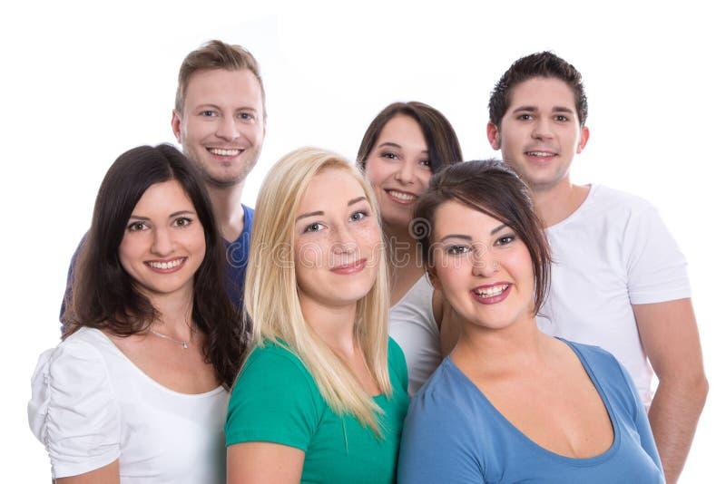 Bon travail d'équipe - adolescents d'isolement heureux - femme et homme - sur W photographie stock