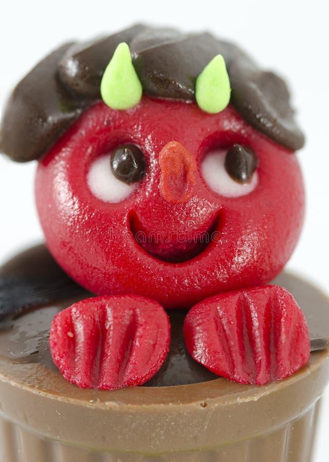 Bonbon geformt wie ein kleiner roter Teufel lizenzfreie stockbilder