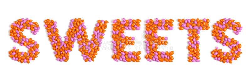Bonbons à mot effectués à partir des sucreries colorées de dragée photo libre de droits