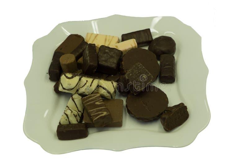 Bonbons au chocolat au-dessus des variations délicieuses blanches de tentation, photos libres de droits