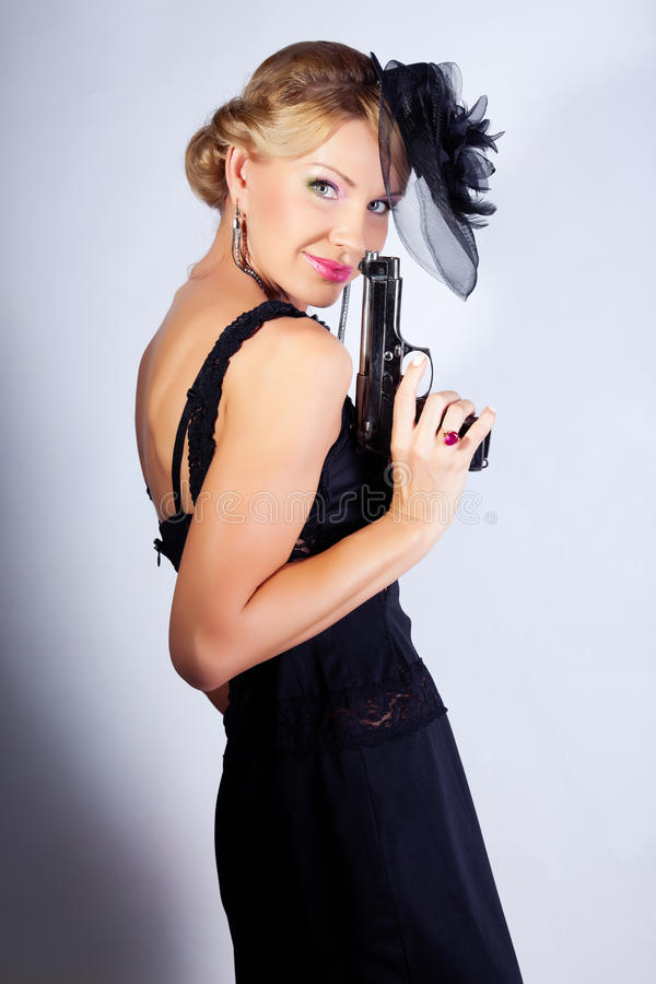 Download Bond woman with gun stock image. Image of lifestyle, female - 25416111
