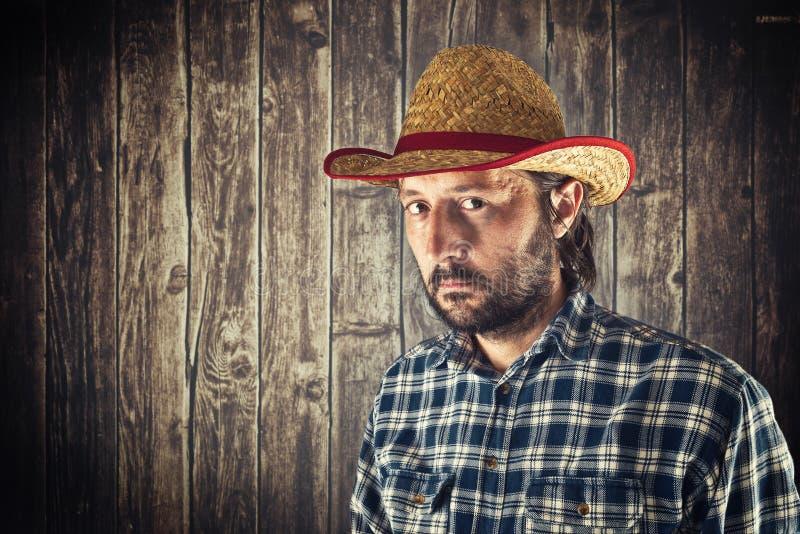 Bonde med cowboysugrörhatten royaltyfria bilder