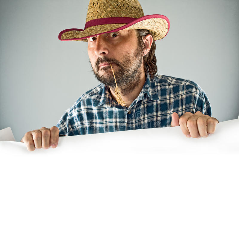 Bonde med cowboysugrörhatten arkivbilder