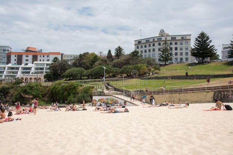 Bondi Beach and Foreshore. SYDNEY,NSW,AUSTRALIA-NOVEMBER 21,2016: Bondi Beach foreshore path, tourists, sandy beach and local architecture under a cloudy sky in stock photo