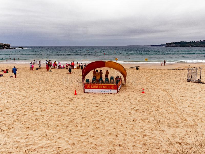 Bondi Beach Life Savers on an Overcast Summer Morning, Sydney, Australia. Life savers or guards, surf rescue, at the yellow sand Bondi Beach, Sydney, NSW royalty free stock photo