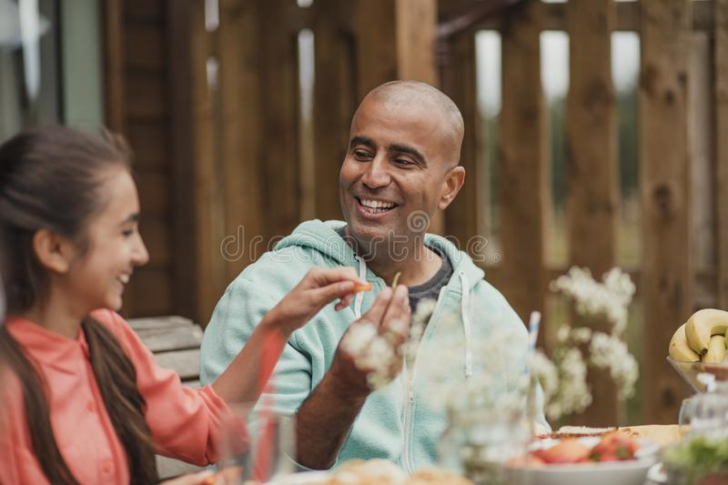 Bonding with Dad at Lunch stock photography