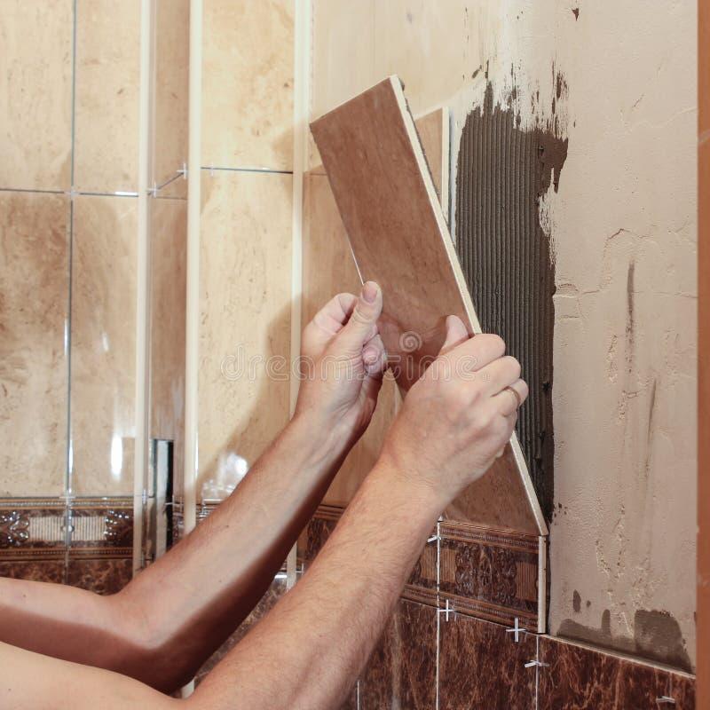 Bonding Of Tiles On The Wall. Stock Photo - Image of equipment ...