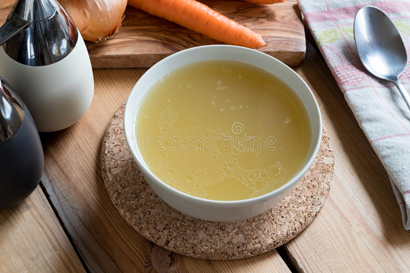 Bone broth made from chicken served in a soup bowl stock photo