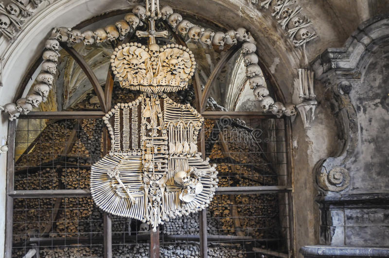 The Bone Church at Kutna Hora - the coat of arms. The Ossuary Chapel of All Saints, aka the bone church at Kutna Hora - Showing the coat of arms made from royalty free stock photography