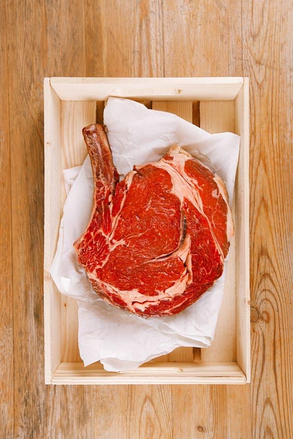 Bone-in Rib Eye Steak Steak On Paper Stock Photo