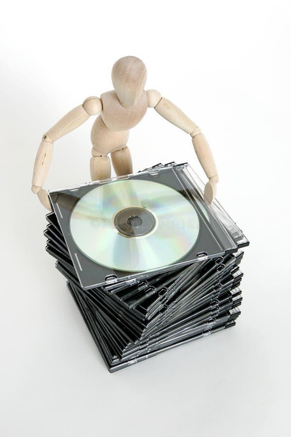 Boneca articulada com pilha cd imagens de stock