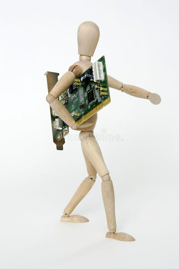 Boneca articulada com placa de circuito do computador foto de stock