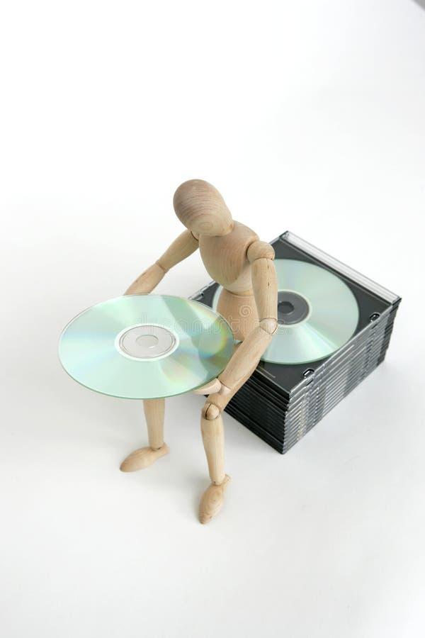 Boneca articulada que senta a pilha cd imagens de stock