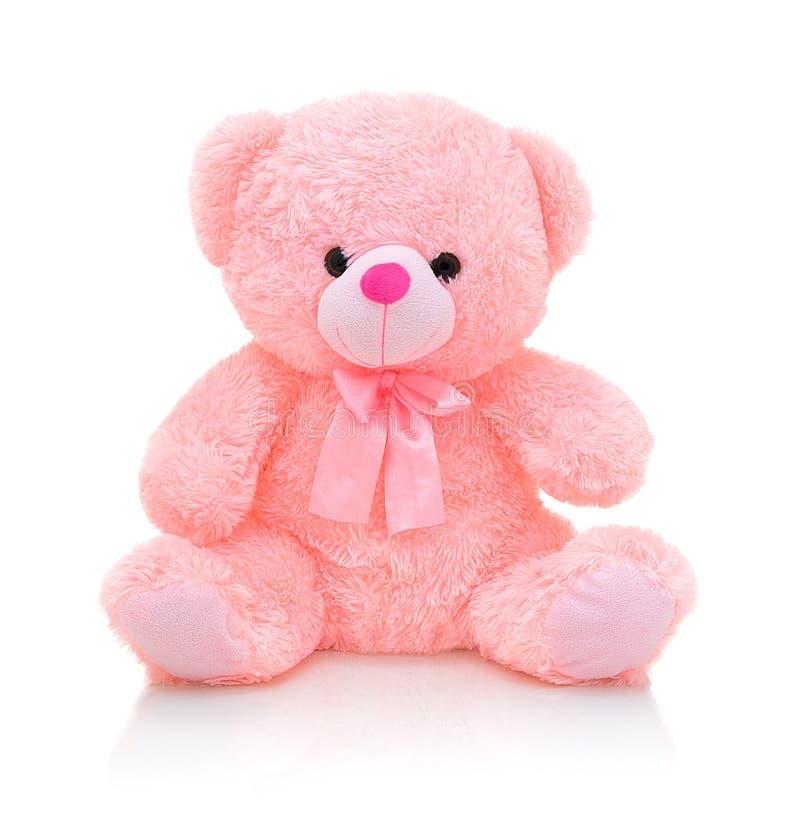 Boneca cor-de-rosa bonito do urso com curva no fundo branco com reflexão da sombra Urso cor-de-rosa brilhante brincalhão imagem de stock