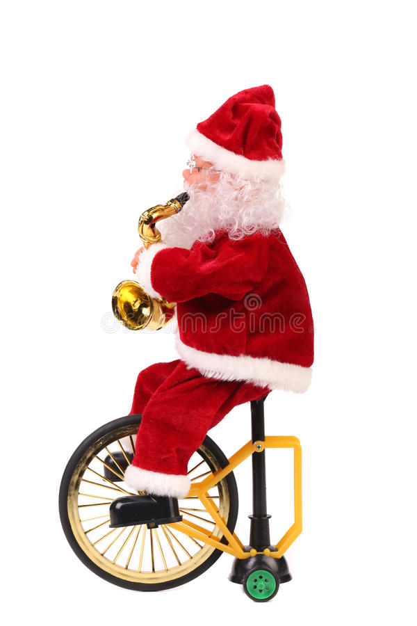 Boneca de Santa Claus em uma bicicleta. foto de stock