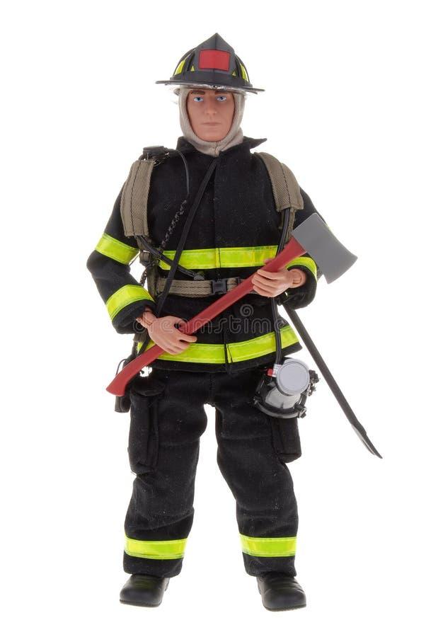 Boneca do brinquedo do bombeiro imagens de stock