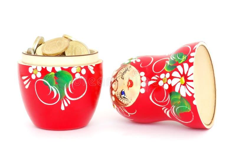 Boneca do russo com moedas imagem de stock
