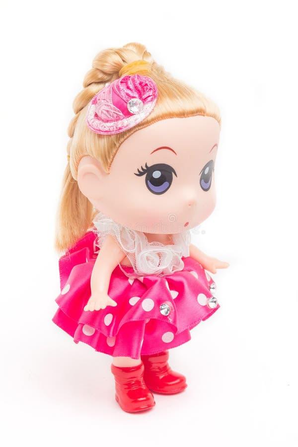 Boneca em um vestido cor-de-rosa fotografia de stock