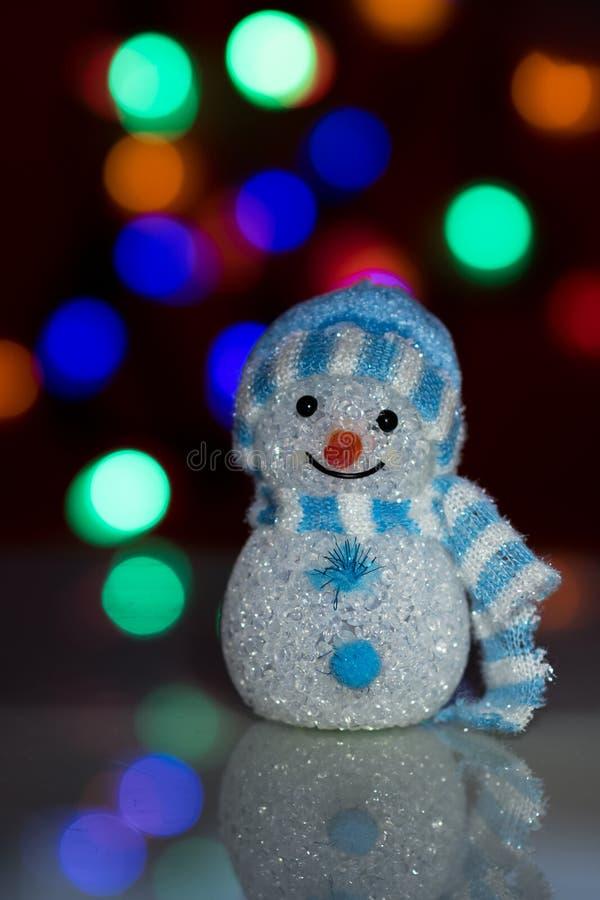 Boneca iluminada do boneco de neve imagens de stock royalty free