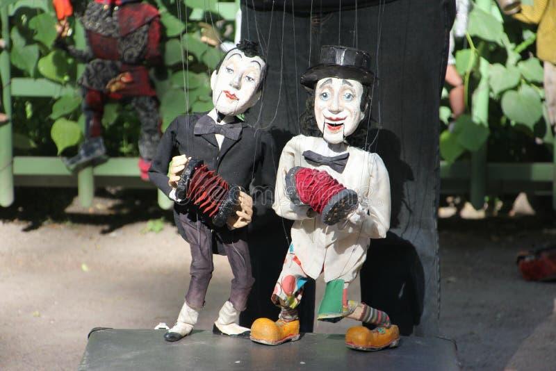 Bonecas de madeira do artista da rua foto de stock royalty free