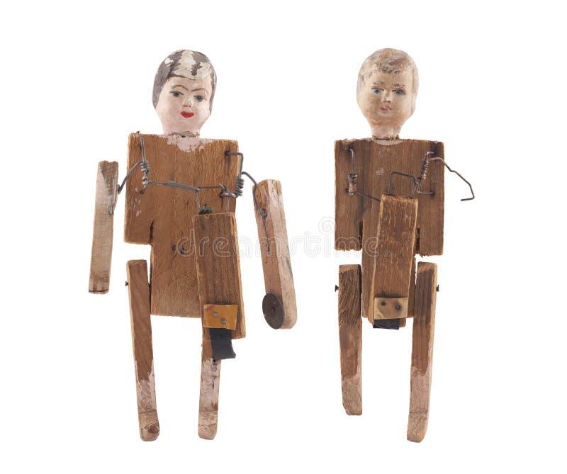 Bonecas de madeira do vintage isoladas no fundo branco com trajeto de grampeamento imagem de stock royalty free