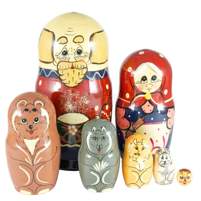 Bonecas do assentamento no conto de fadas Kolobok em duas fileiras foto de stock
