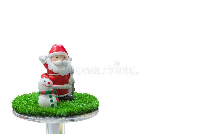 Bonecas e boneco de neve de Santa Claus para as decorações do Natal isoladas no fundo do whith foto de stock royalty free