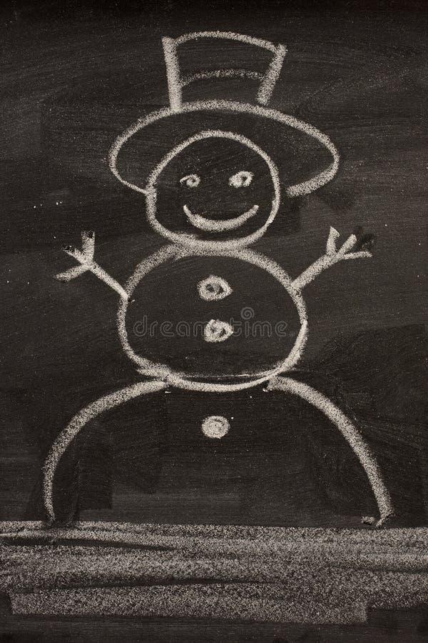 Boneco de neve no quadro-negro imagens de stock