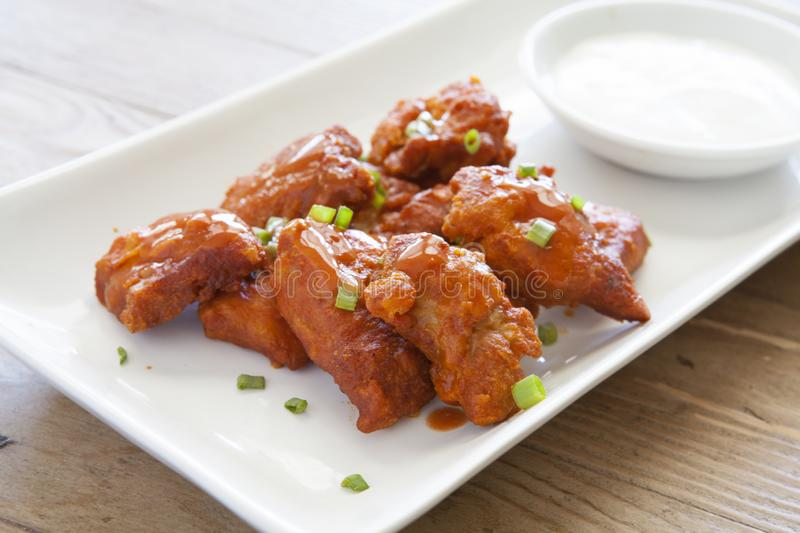 Boneless Buffalo Wings with Ranch Dressing. On a wooden background royalty free stock photography