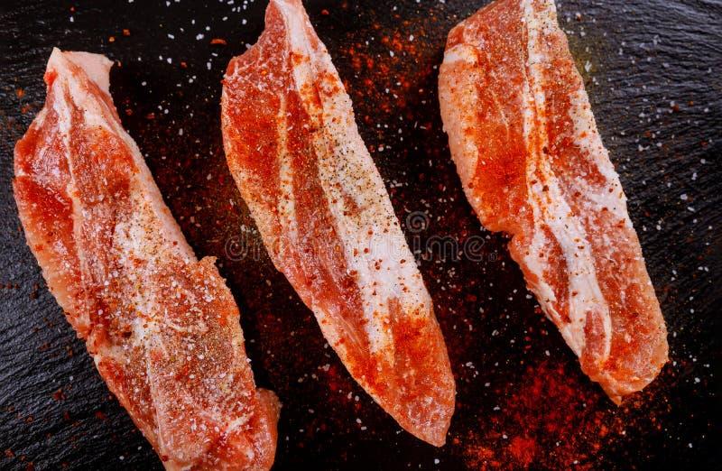 Boneless pork chops seasoned with dried tomatoes, paprika stock image