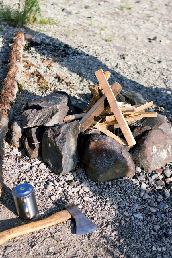 Bonfire and axe camp stone out of nature. Outdoor firewood stock photos