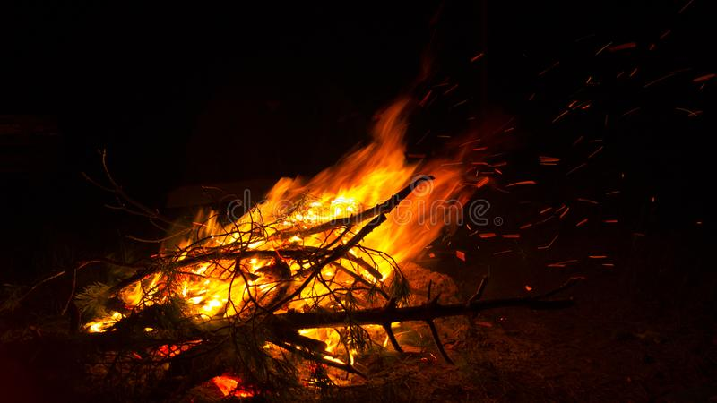 Bonfire on the beach at night, background, abstraction stock photos