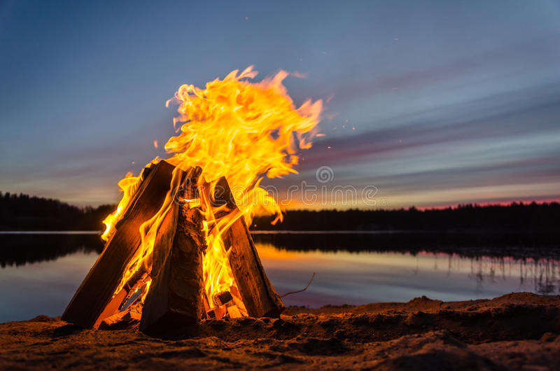 Bonfire on the beach sand stock photography