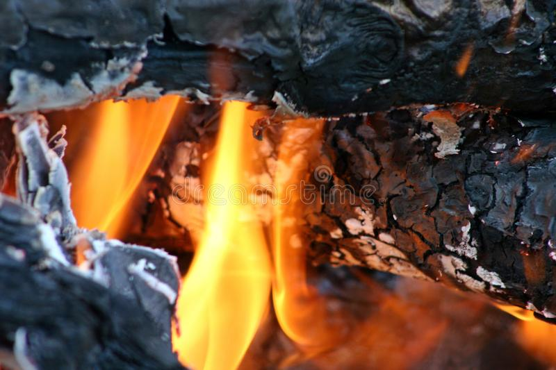 Bonfire campfire, pyre in the day time. Round logs burning. stock photos