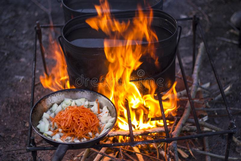 Bonfire in camping trip. Ð¡amping trip,bonfire, cooking food on fire stock image