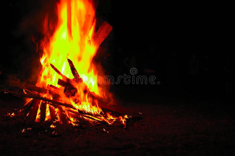 Bonfire on a dark background. Beautiful fire flames with copy space on black. Burning wood at night. Campfire at touristic camp. stock images