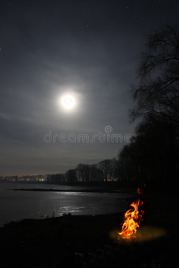 Free Bonfire Flame And Moon Over Lake Stock Photos - 7419393