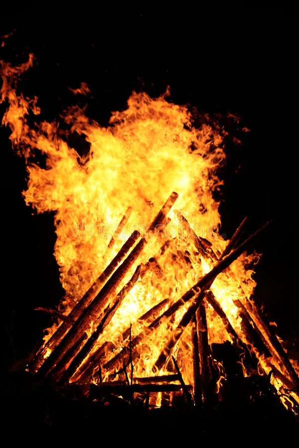 Bonfire flame outdoors. Bright bonfire flame on the rural field at evening royalty free stock photo