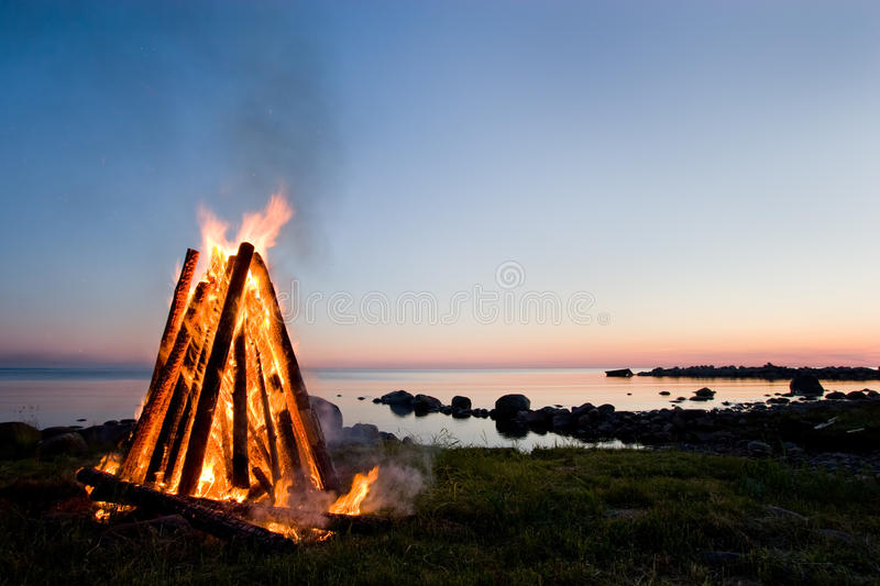 Bonfire and sunset sky royalty free stock photography