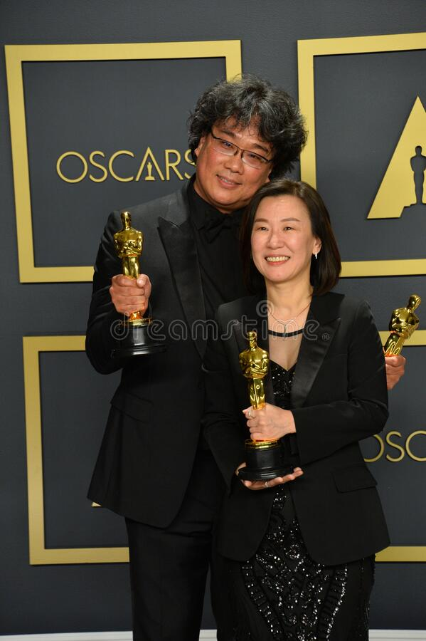 Bong Joon Ho & Kwak Sin-ae. LOS ANGELES, USA. February 09, 2020: Bong Joon Ho & Kwak Sin-ae at the 92nd Academy Awards at the Dolby Theatre..Picture: Paul Smith/ stock images
