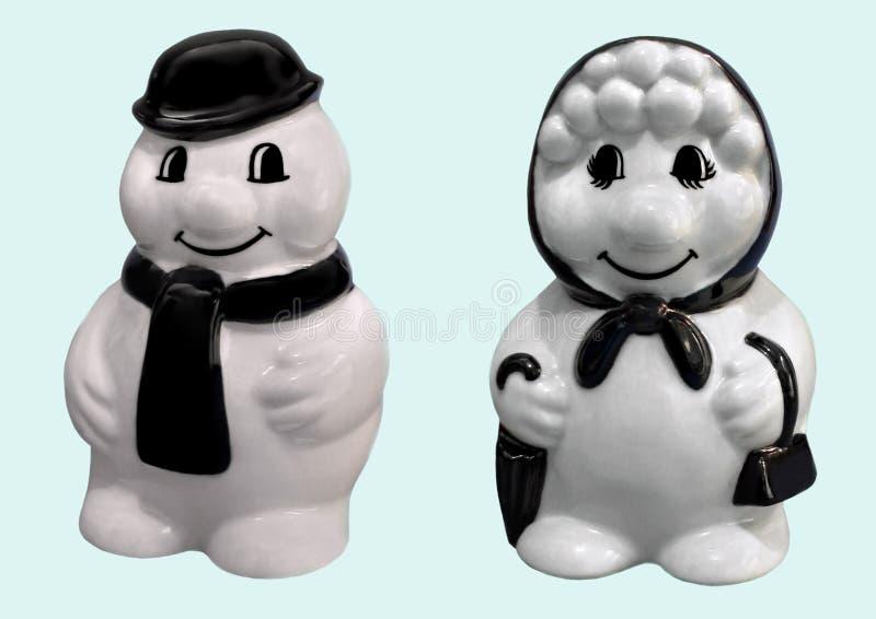 Bonhomme de neige et femme de sourire heureux de neige photos libres de droits